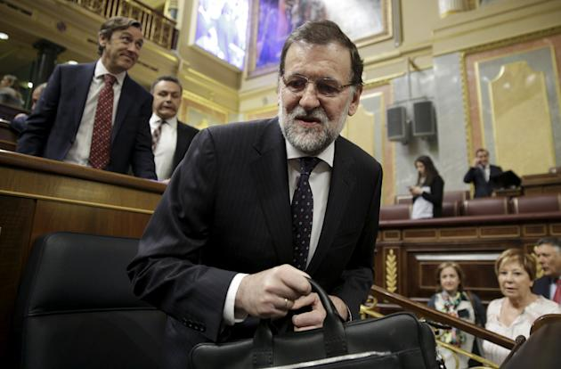 Spain's Prime Minister Mariano Rajoy arrives for a government control session at Spain's Parliament in Madrid, Spain