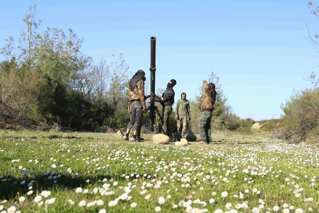 Ansar al-Sham brigade fighters, part of the Free Syrian Army, prepare a grad launcher before firing towards forces loyal to Syria's president Bashar Al-Assad in the Selma area of the Latakia count