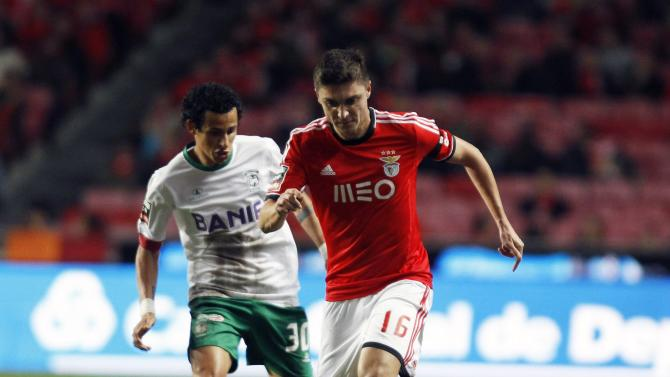 Benfica's Siqueira fights for the ball with Maritimo's Dias during their Portuguese Premier League match in Lisbon