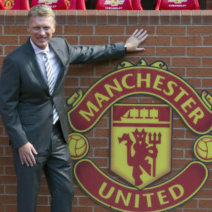 "FILE - In this Friday July 5, 2013 file photo Manchester United's new manager David Moyes poses for pictures before a press conference at Old Trafford Stadium, Manchester, England. Manchester United says manager David Moyes has left the Premier League club after less than a year in charge, amid heavy speculation he was about to be fired. United released a brief statement in its website Tuesday, saying the club ""would like to place on record its thanks for the hard work, honesty and integrity he brought to the role."" (AP Photo/Jon Super, File)"