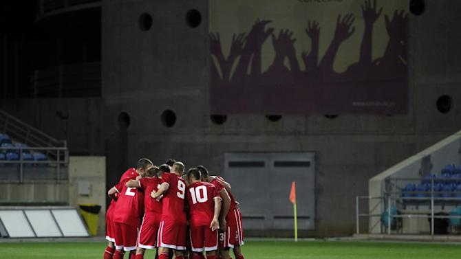 Gibraltar's players gather before the start of a friendly soccer match between Gibraltar and Slovakia at the Algarve stadium in Faro, southern Portugal, Tuesday, Nov. 19, 2013. Gibraltar played its first international soccer match as a new full member of the UEFA after they were accepted in May. The match ended in a 0-0 draw