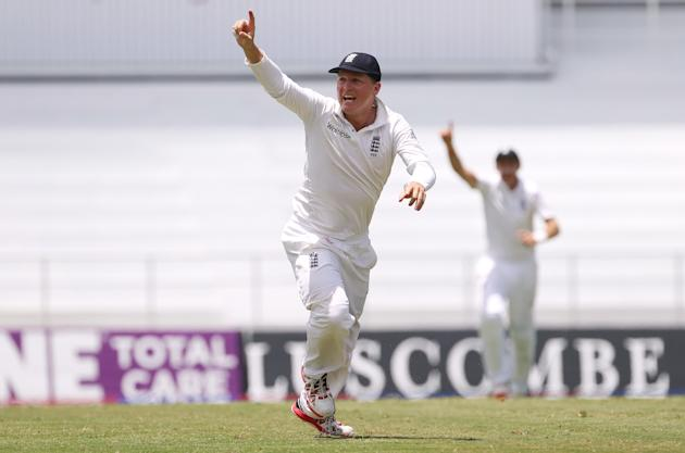 Cricket: England's Gary Ballance celebrates after James Anderson ran out Jason Holder