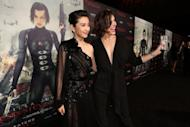 "Actresses Li Bingbing (L) and Milla Jovovich arrive at the Los Angeles premiere of ""Resident Evil: Retribution"" at Regal Cinemas L.A. Live on September 12, in Los Angeles, California"