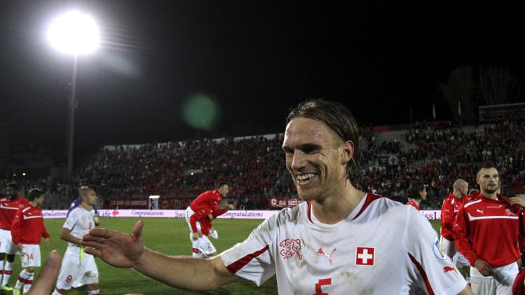Switzerland's Michael Lang celebrates after his team beat Albania during their 2014 World Cup qualifying soccer match in Tirana
