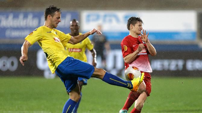 Estoril's Yohan Tavares, left, clears the ball in front of Freiburg's Vaclav Pilar from the Czech Republic during their Europa League group H soccer match Thursday, Nov. 7 2013, in Estoril, Portugal