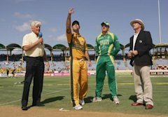 GROS ISLET, SAINT LUCIA - APRIL 25: Ricky Ponting of Australia tosses the coin watched by Graeme Smith of South Africa, commentator Barry Richards and...