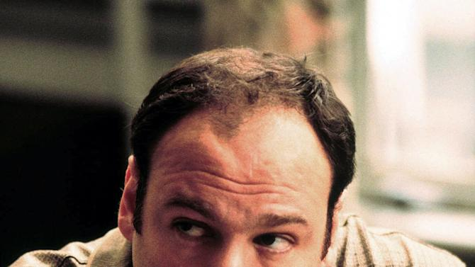 "FILE - This 1999 file photo released by HBO shows actor James Gandolfini as Tony Soprano in the critically acclaimed HBO series ""The Sopranos.""  Gandolfini's portrayal of Tony Soprano represented more than just a memorable TV character. He changed the medium, making fellow antiheroes like Walter White and Don Draper possible, and shifted the balance in quality drama away from broadcast television.  Gandolfini died Wednesday, June 19, 2013, in Italy. He was 51. (AP Photo/HBO, Anthony Nesta, file)"