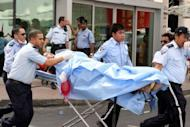One of the survivors recieves medical care outside Doha's Villaggio Mall after a fire broke out inside the upscale shopping centre, killing at least 19 people, including 13 children