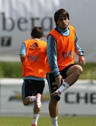 Spain's Benat Etxebarria warms up during a training session in Schruns. Sevilla striker Alvaro Negredo edged Roberto Soldado for the final striker's spot in defending champions Spain's squad for Euro 2012 that was announced by coach Vicent del Bosque