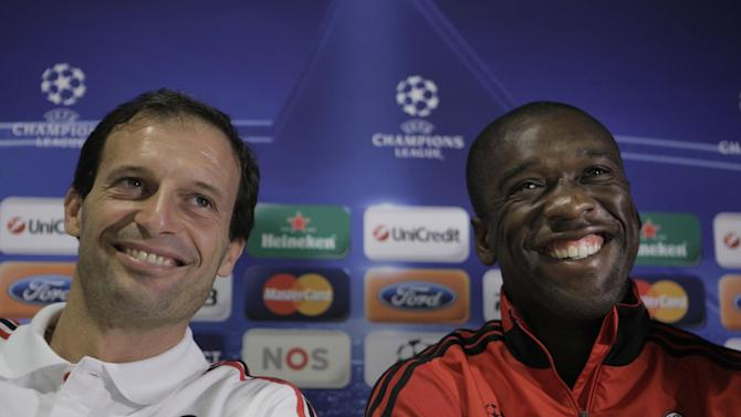 In this Sept. 27, 2010 file photo, AC Milan coach Massimiliano Allegri, left, and player Clarence Seedorf answer questions during a press conference at ArenA stadium in Amsterdam, Netherlands. Clarence Seedorf said Tuesday he will take over as the new coach at AC Milan, replacing Allegri who was on Monday. Seedorf made the announcement at Brazilian club Botafogo, where he has been playing