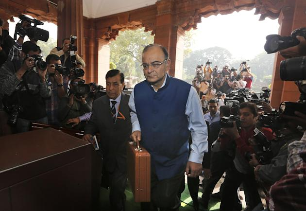 Indian Finance Minister Arun Jaitley arrives at the Parliament House to present Union Budget for the year 2015-16, in New Delhi, India, Saturday, Feb. 28, 2015. The Economic Survey, an annual report o