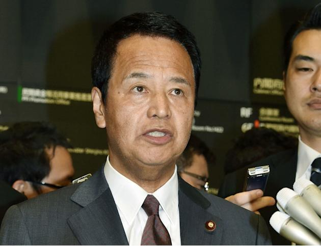 Japan's Economy Minister Akira Amari speaks to reporters after talks with the U.S. counterpart in Tokyo early Tuesday, April 21, 2015. The U.S. and Japan need further work to resolve differences o
