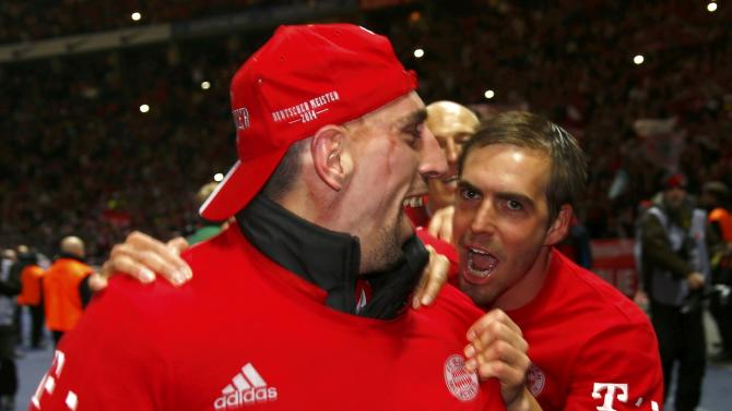 Bayern Munich's Ribery and Lahm celebrate winning Bundesliga title after German first division Bundesliga soccer match against Hertha Berlin in Berlin