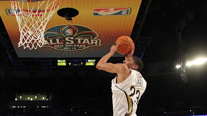 Team Webber's Anthony Davis of the New Orleans Pelicans heads to the basket as Team Hill's Bradley Beal of the Washington Capitals look son during the Rising Star NBA All Star Challenge Basketball game,, Friday, Feb. 14, 2014, in New Orleans