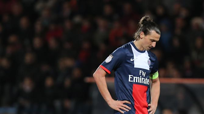 Paris Saint Germain's forward Zlatan Ibrahimovic of Sweden look at the ground during his French League one soccer match, in Lorient, western France, Friday, March 21, 2014