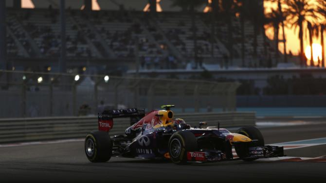 Red Bull Formula One driver Webber of Australia takes a corner during the qualifying session of the Abu Dhabi F1 Grand Prix at the Yas Marina circuit on Yas Island