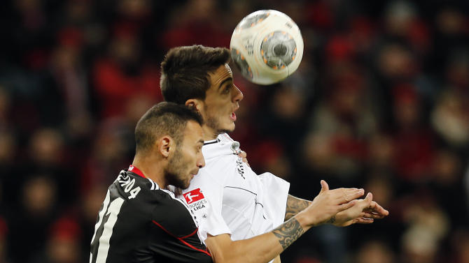 Leverkusen's Omer Toprak of Turkey, left, and Frankfurt's Joselu of Spain challenge for the ball during the German first division Bundesliga soccer match between Bayer Leverkusen and Eintracht Frankfurt in Leverkusen, Germany, Sunday, Dec. 15, 2013