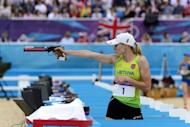 Lithuania's Laura Asadauskaite aims during the shooting event of the women's Modern Pentathlon during the 2012 London Olympics at the Equestrian venue in Greenwich Park, London
