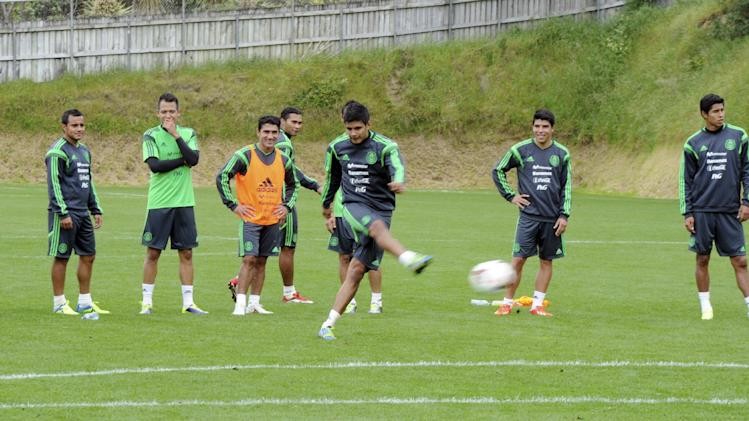 Mexico's players train for their upcoming World Cup qualifying soccer match against New Zealand at Dave Farrington Park, in Wellington, New Zealand, Sunday, Nov. 17, 2013