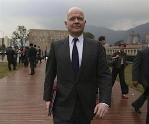 British Foreign Minister William Hague leaves after participating in a forum against sexual violence in conflict in Bogota