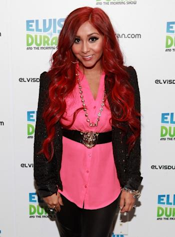 Red alert! Nicole 'Snooki' Polizzi shows off her new color while visiting the Z100 Studio in New York City on November 15, 2012 -- Getty Premium