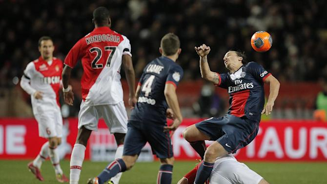 Paris Saint Germain's Zlatan Ibrahimovic of Sweden, right, challenges for the ball during the French League One soccer match, against Monaco, in Monaco stadium, Sunday, Feb. 9 , 2014