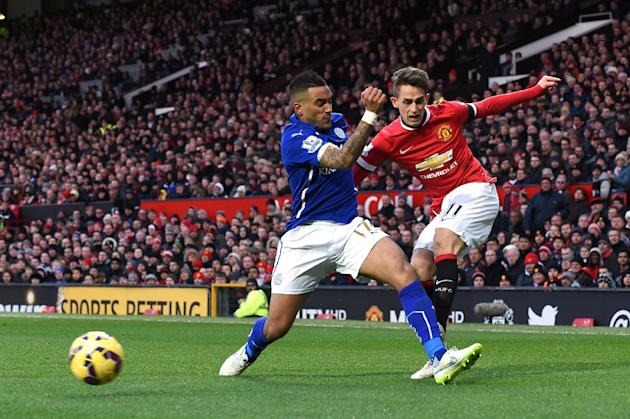 Manchester United's Belgian midfielder Adnan Januzaj (R) gets a cross past Leicester City's English defender Danny Simpson during the English Premier League football match in Manchester, Engla