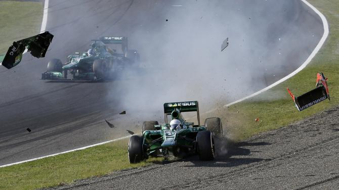 Caterham Formula One driver van der Garde of Netherlands crashes after colliding with Marussia Formula One driver Bianchi of France during the Japanese F1 Grand Prix at the Suzuka circuit
