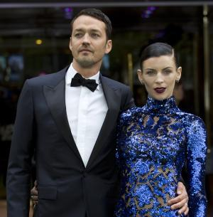 """FILE - In this May 14, 2012 file photo, actress Liberty Ross with director Rupert Sanders pose for the media at the World Premiere of the film, """"Snow White and the Huntsman,"""" at a cinema in central London. Ross filed for divorce on Friday, Jan. 28, 2013 in Los Angeles, roughly five months after it was revealed that Sanders had engaged in a brief affair with actress Kristen Stewart. (AP Photo/Alastair Grant, File)"""