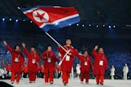 Song Chol Ri of North Korea carries the national flag during the Opening Ceremony of the 2010 Vancouver Winter Olympics at BC Place in 2010 in Vancouver, Canada. North Korea said it would send 49 athletes to compete in 11 sports in this summer's London Olympics and is seeking a record number of medals
