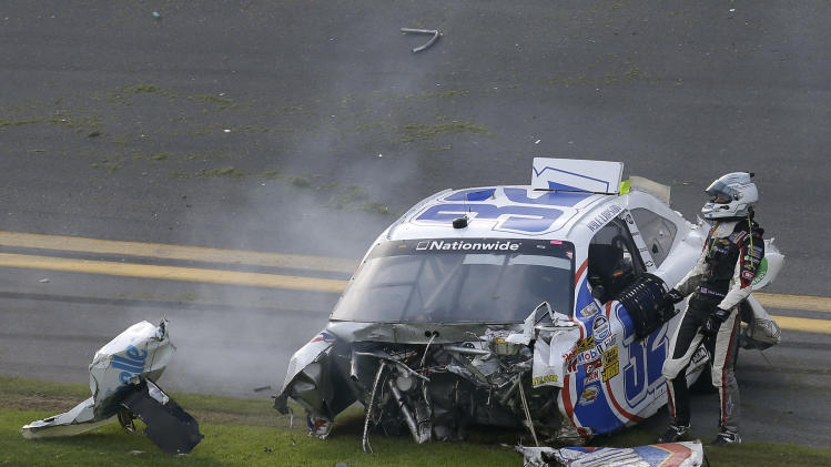 Kyle Larson climbs out of his car after being involved in a crash at the conclusion of the NASCAR Nationwide Series auto race Saturday, Feb. 23, 2013, at Daytona International Speedway in Daytona Beach, Fla. (AP Photo/Chris O'Meara)