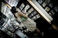 A woman listens to a CD in a music shop in Hong Kong. A 2011 forecast from technology consultancy firm Ovum said the Asia Pacific region will account for 35% of global digital music revenues to the tune of $7 bn by 2015, out of a global figure of $20 bn