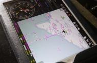 Search area is seen on an iPad of a military officer onboard a Vietnam Air Force AN-26 aircraft, during a mission to find the missing Malaysia Airlines flight MH370, off Con Dao island, March 13, 2014. REUTERS/Kham
