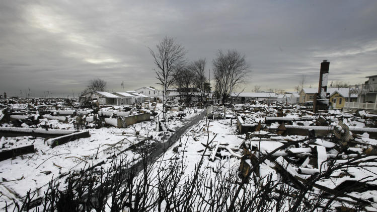 The fire-scorched landscape of Breezy Point is shown after a Nor'easter snow, Thursday, Nov. 8, 2012 in New York.  The beachfront neighborhood was devastated during Superstorm Sandy when a fire pushed by the raging winds destroyed many homes.  (AP Photo/Mark Lennihan)