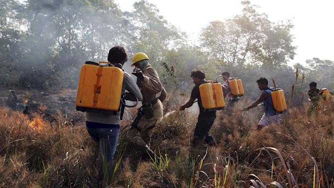 Firefighters and members of indigenous tribes attend a training at the Kamayura tribe, to combat wildfire in the Xingu National Park, Mato Grosso, Brazil