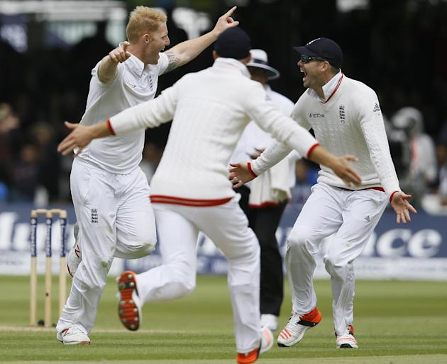 England's Ben Stokes, left, and James Anderson, right, celebrate taking the wicket of New Zealand's captain Brendon McCullum during the fifth day of the first Test match between England and Ne