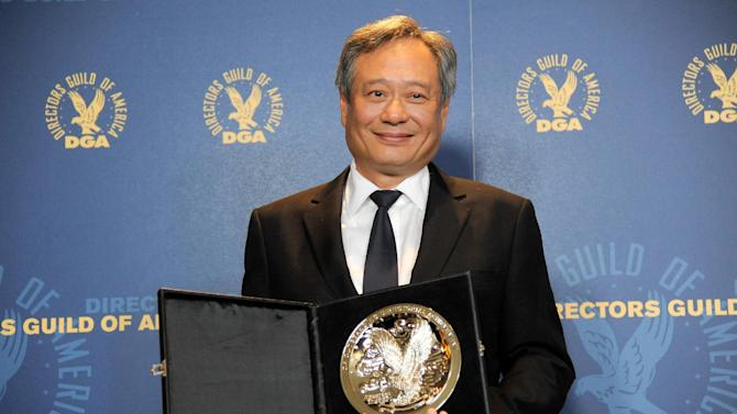 "FILE - In this Saturday, Feb. 2, 2013 file photo, Ang Lee poses backstage with his feature film nomination plaque for ""Life of Pi"" at the 65th Annual Directors Guild of America Awards at the Ray Dolby Ballroom, in Los Angeles.  With 11 Academy Awards nominations, second only to ""Lincoln"" with 12, and the sort of global box-office receipts normally reserved for superheroes, ""Life of Pi"" is one of the most unusual megahits ever to hit the big-screen. (Photo by Chris Pizzello/Invision/AP, File)"