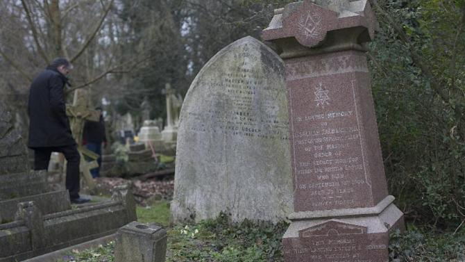 The grave of Dr Isachar Zacharie which stands lopsided amongst other decaying tombs in Highgate Cemetery in north London Thursday, Feb. 28, 2013. Zacharie,, best known as Abraham Lincoln's foot doctor, treating him and many members of the United States army during the US Civil War,  died in London in 1900 and is buried in the same cemetery that also contains the remains of the philosopher Karl Marx . (AP Photo/Alastair Grant)
