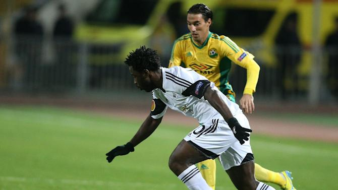 Swansea City's Wilfried Bony, foreground, controls the ball as Kuban Krasnodar's Ivelin Popov follows him, background, during their Europa League group A soccer match at a stadium in Krasnodar, Russia, Thursday, Nov. 7 2013