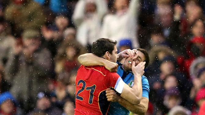 Italy's Edoardo Gori, right, fights with Scotland's Sam Hidalgo-Clyne during their Six Nations rugby union international match at Murrayfield stadium, Edinburgh, Scotland, Saturday Feb. 28, 2015. (AP Photo/Scott Heppell)