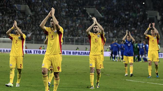 Romania's players applaud their fans after their World Cup qualifying playoff first leg soccer match against Greece at the Karaiskaki stadium in the port city of Piraeus, near Athens, Friday, Nov. 15, 2013. Greece won 3-1