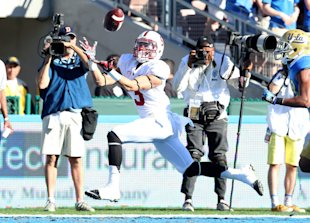 PASADENA, CA - NOVEMBER 28: Michael Rector #3 of the Stanford Cardinal makes a 22 yard touchdown catch against the UCLA Bruins at the Rose Bowl on November 28, 2014 in Pasadena, California. (Photo by Stephen Dunn/Getty Images)
