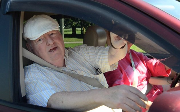 Senator Mike Duffy speaks while in his vehicle outside a pet kennel in Kensington, P.E.I. (Reuters)