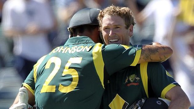 Australia's batsman George Bailey (R) is congratulated by teammate Mitchell Johnson (L)