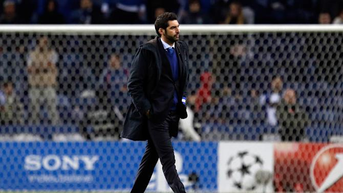 CORRECT TO JEERED Porto's coach Paulo Fonseca leaves the pitch jeered by supporters at the end of the Champions League group G soccer match between FC Porto and Austria Vienna Tuesday, Nov. 26, 2013, at the Dragao stadium in Porto, northern Portugal. The game ended in a 1-1 draw
