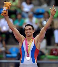 Colombian gymnast Jorge Giraldo celebrates with the silver medal after the gymnastics pommel horse competition during the XVI Pan-American Games in Guadalajara, Mexico, on October 27, 2011. AFP PHOTO/CRIS BOURONCLE