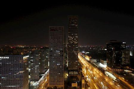 A general view shows Yintai Centre buildings, with their red lights on top turned off, during Earth Hour in Beijing's central business district