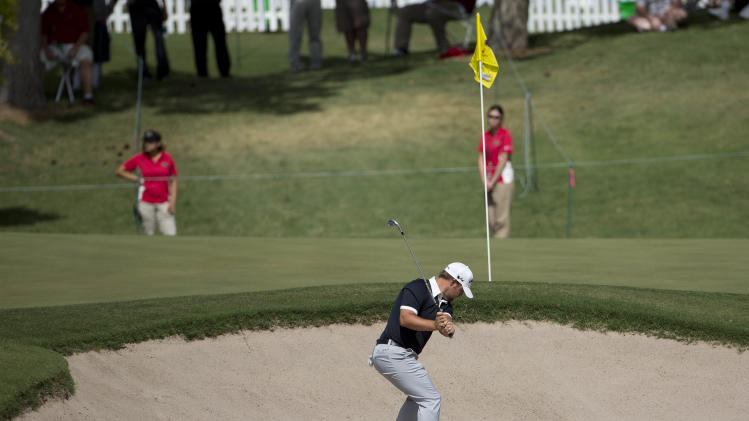 Ryan Moore hits out of the bunker to the ninth green during the first round of the Justin Timberlake Shriners Hospitals for Children Open golf tournament, Thursday, Oct. 4, 2012, in Las Vegas. Moore birdied the hole and finished at 10-under par for the round. (AP Photo/Julie Jacobson)
