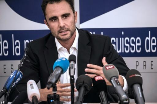Herve Falciani, the former HSBC employee who leaked documents alleging the bank helped clients evade millions of dollars in taxes, gestures as he gives a press conference in Divonne-les Bains on October 28, 2015