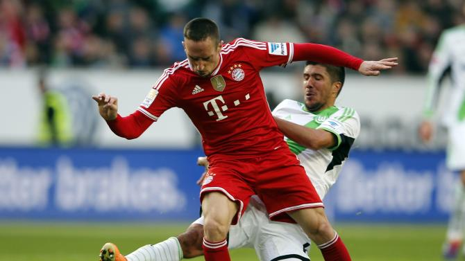 Bayern Munich's Franck Ribery is tackled by Wolfsburg's Slobodan Medojevic during their German first division Bundesliga soccer match in Wolfsburg